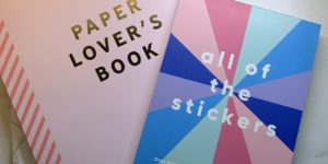Two Kikki K stationery items, one titled Paper Lover's book and the other titled All of the stickers