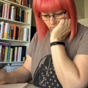 Photo of Karen writing in a notebook